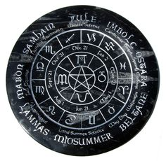 """Beautiful 12"""" round Black Orthoceras Fossil Plate fully Engraved with the Pagan Wheel of the Year Calendar! Finished in Silver leaf, this plate is made of Orthoceras, a fossil from the Silurian Period"""