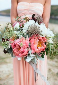 Modern Peony Bouquet with Protea. The Blue Carrot, a florist based out of Cornwall, England, created this modern bouquet with coral charm peonies, succulents, and proteas for a unique look.