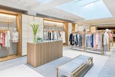 Although presented as one department, the different types of clothing are displayed in their own spaces. Each uses similar materials in a variety of ways, particularly for furniture, fixtures and display racks.