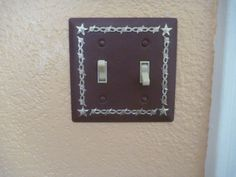 Western star and barbed wire metal switch plate cover.