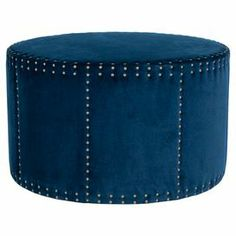 """Cotton-upholstered ottoman in navy with nailhead trim.  Product: OttomanConstruction Material: Plywood and cotton upholsteryColor: NavyFeatures: Nailhead trimDimensions: 20.1"""" H x 33.9 """" Diameter"""
