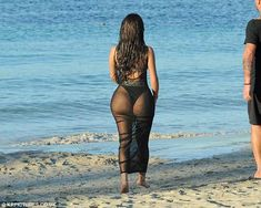 What a view: Demi flaunted her pert derriere as she sauntered off toward the water ...
