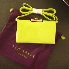 "Ted Baker Neon Green Cross Body Details: - Detachable crossbody strap - Framed with crystal bow kiss-lock closure and foldover magnetic flap - Exterior features patent finish - Interior features wall zip pocket and 3 card slots - Dust bag included - Approx. 4.25"" H x 7"" W x 1"" D - Approx. 24"" strap drop Ted Baker Bags Crossbody Bags"