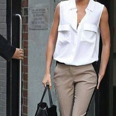 This classy pairs a pretty white blouse with beigetuxedo pants. The opened blouse is sexy and the pumps give the look a sophisticated edge. You could easily dress this down with flats... but I personally love the black pumps! I even love the simple pony tail. The way this outfit is styled in the p