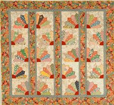 Really pretty color schemem. Like the use of vertical sashings. Nice layout!an quilt