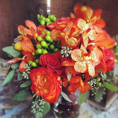 Mokara Orchids, Hypericum Berry, Seeded Eucalyptus and Roses by http://petalandbean.com