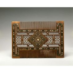 Comb - probably Granada, Spain, boxwood with pierced and marquetry decoration and sdtudded with silver, Hood Ornaments, Marquetry, Victoria And Albert Museum, Leaded Glass, Ancient History, Art And Architecture, Metal Working, Horns, Glass Art