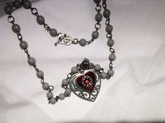A personal favorite from my Etsy shop https://www.etsy.com/listing/246266043/double-heart-pendant-pewter-red-enamel