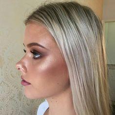 Gorgeous glowing makeup by Australian makeup artist Mia Connor. Soft smokey eye & stunning highlight