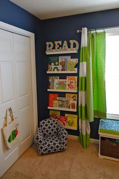 Whimsical Blue, Orange and Green Nursery If you have an awkward, small wall in the nursery - why not create a mini library wall?If you have an awkward, small wall in the nursery - why not create a mini library wall? Library Wall, Mini Library, Library Corner, Library Chair, Ideas Dormitorios, Toddler Rooms, Boys Bedroom Ideas Toddler Small, Toddler Boy Room Decor, Baby Boy Nurseries