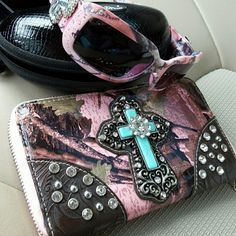 Montana West Wristlet and Sunglasses with Bling Never used pink camo wristlet with pink camo sunglasses. Both have all the rhinestones in tact. No scratches on either of them. Both of them are new and have never been used. Open to offers! Any questions, please ask! :)  Montana West Accessories