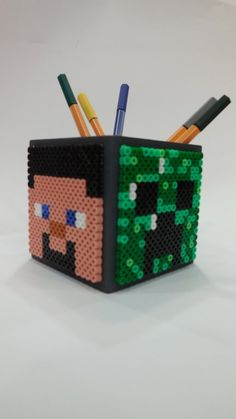 DIY Minecraft pencil holder hama beads by Daphnée Merigna Minecraft Diy, Minecraft Room Decor, Hama Beads Minecraft, Minecraft Bedroom, Creeper Minecraft, Lego Bedroom, Minecraft Furniture, Minecraft Skins, Childs Bedroom