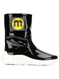 Shop online black Miu Miu logo patch ankle boots as well as new season, new arrivals daily. Black Leather Boots, Black Ankle Boots, Miu Miu, Miuccia Prada, Cool Boots, Sophisticated Style, Ugg Boots, Baby Design, Fashion Brand
