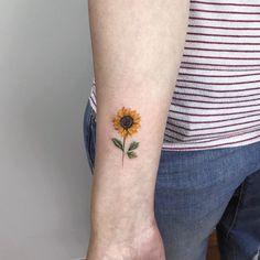 Tattoo red poppy tattoo on shoulder tiny flower tattoos on arm sun Sunflower Tattoo On Wrist, Sunflower Tattoos, Sunflower Tattoo Design, Tiny Flower Tattoos, Beautiful Flower Tattoos, Little Tattoos, Tiny Tattoo, Delicate Flower Tattoo, Small Tattoo Designs