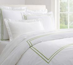 Pearl Embroidered 280-Thread-Count Duvet Cover & Shams | Pottery Barn - this hotel-type bedding always looks beautiful and timeless. You can add color with pillows and throws or keep that clean white look.