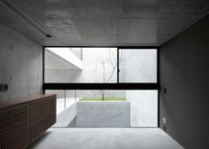 This raw concrete house in Tokyo was designed by Japanese firm Apollo Architects & Associates as a family home for a couple whose interests include contemporary art and cars.