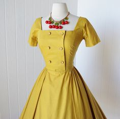 vintage 1950's dress ...classic JONATHAN LOGAN golden by traven7, $170.00  Wow, look at the dress AND the necklace!