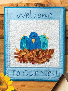 This is the sweetest quilt! Perfect for hanging on a door. #quilt #pattern #spring #welcome #affiliate