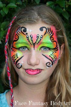 Neon butterfly facepaint design by Face Fantasy BodyArt. Copyright.