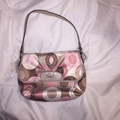 Small Coach Purse Brown, Pink, and White Purse. Pink inside. Never used, with tags. No rips or stains. Coach Bags