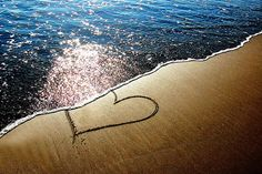 heart in sand-I love the sun sparkling on the water!