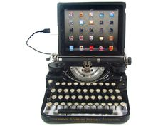 This antique typewriter has been modified to work as a USB Keyboard for PC, Mac, or even iPad! That's right -- its a beautiful and fully functional computer keyboard!