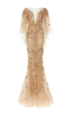 This **Marchesa** gown features a plunging V neckline, butterfly style sleeves, and multi color crystal embroidery.