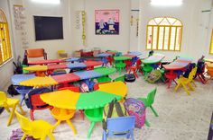 Remarkable Contemporary Kids Class Room of Interior Design School with Hodgepodge Tables and Chairs in Colorful also Furnished with Chalkboard