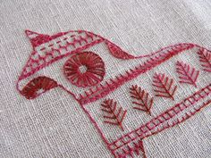 Folk Embroidery Patterns Most countries have their own unique tradition of folk embroidery using stitches which form particular patterns with different meanings for use in celebrations, storytelling, commemoration of histo… Scandinavian Embroidery, Swedish Embroidery, Embroidery Applique, Cross Stitch Embroidery, Embroidery Patterns, Red Work Embroidery, Indian Embroidery, Textiles, Needlework