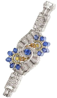 An impressive art deco sapphire diamond and coloured diamond bracelet by Oscar Heyman.
