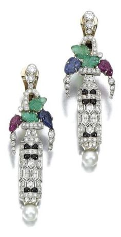 A  PAIR OF GEM-SET DIAMOND EARRINGS a pair of earrings with carved emeralds, rubies and sapphires, accented with onyx, a cultured pearl and brilliant-cut diamonds, clip fittings.
