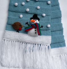 Knitting pattern for Let It Snow Scarf - This scarf features separately knitted snowman, snowflake & robin details which are stitched to the finished scar