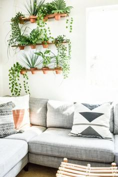 Build a unique indoor DIY vertical garden for your faux plants. This hanging garden living wall is the perfect thing to add Boho style to your home or apartment. Decor, Faux Plants, Chic Home Decor, House Plants Indoor, Vertical Garden Diy, Living Room Decor, Hanging Plants Indoor, Indoor Plant Pots, Garden Living