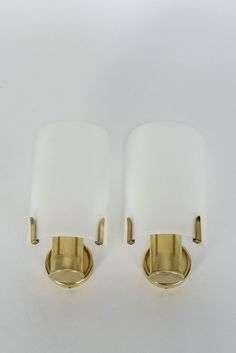 Pair of Swiss Brass and Lucite Wall Sconces, 1960s | From a unique collection of antique and modern wall lights and sconces at https://www.1stdibs.com/furniture/lighting/sconces-wall-lights/