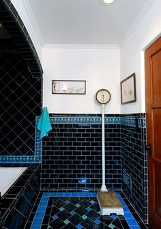 Good Home Construction's Renovation Blog: 1920's Spanish-Revival Art Deco Bathroom ----- This color scheme is absolutely gorgeous. The black with the cornflower and the turquoise/aqua, all set off with white. LOVE IT. Maybe we could use this color scheme somewhere....