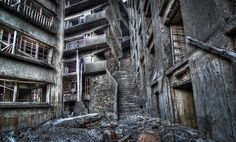 In the past Hashima Island was rich in coal, with over 5000 miners once living on the island. When petrol replaced coal as Japan's main source of fuel, the settlement was left abandoned. Now the once thriving town is creepily abandoned, with only shadows remaining.