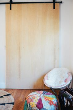 Barn door track purchased on Amazon. for living room? Installed using Birch plywood.