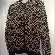 JUICY COUTURE ANIMAL PRINT HOODIE JUICY COUTURE ANIMAL PRINT HOODIE...worn once...great condition!!! Sleeves and bottom are ribbed in black. Signature J zipper pull. Material is cotton, polyester and spandex. So cute!!! Juicy Couture Tops Sweatshirts & Hoodies