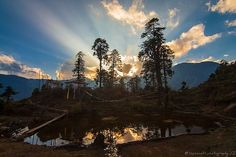 Tshokha Monastery with magical light rays during sunset in #Sikkim.
