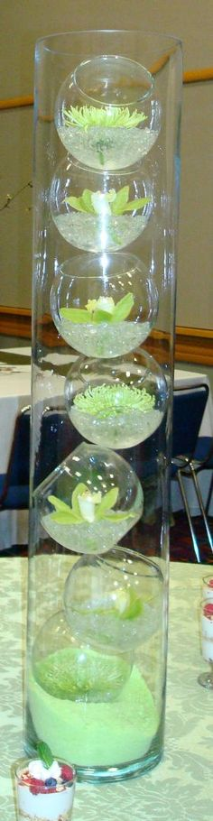 Stacked bubble bowls in a large cylinder vase centerpiece (fruit flowers centerpiece)