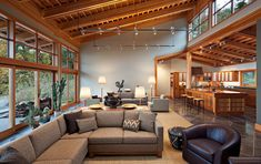 Pacific Northwest Contemporary This spacious Vashon home built for an internationally known wildlife photographer combines the elegant structure of a Japanese timber house with the rugged feel of a...