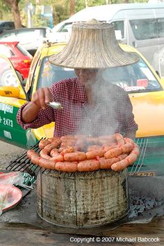 Sour Sausage vendor at Ayuthaya, Thailand   - Explore the World with Travel Nerd Nici, one Country at a Time. http://TravelNerdNici.com