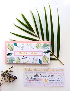 Hot, tropical palm leaves indian themed wedding invitations.
