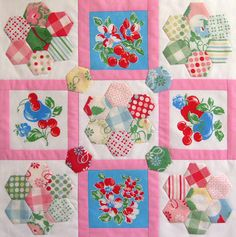 I like the idea of putting hexagonal flowers and embroidery between sashing but I think I would use softer colours
