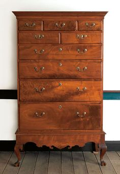Pennsylvania Queen Anne walnut chest on frame, ca. 1760, with a bold cornice above five short drawers and four long graduated drawers, all resting on a base with a scalloped skirt and short cabriole legs terminating in stocking trifid feet, 68.5 H. x 38 W. Provenance: H.L. Chalfant Antiques.