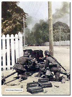 German soldiers firing a 37 mm Pak 35/36 anti-tank gun at Russian trucks. A town in Russia