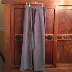 Grey Lululemon Sweats Very cozy grey Lululemon sweats. Wide leg, 33' inseam. Small discoloration/bleach spot on left knee. Super comfortable! Just purchased from Posh, just didn't fit me quite right. lululemon athletica Pants Wide Leg