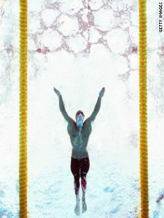 Setting another world record (1.52.49) USA's Michael Phelps wins the men's 200-meter butterfly final at the Beijing 2008 Olympic Games.