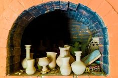 A Picture Of A Brick Kiln With Pottery Inside