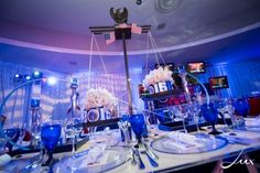 These scale centerpieces had alternating red, white, and blue flowers for a political themed Bar Mitzvah! | MitzvahMarket.com
